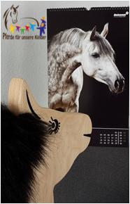 """Termine """"Pferde für unsere Kinder e.V."""" - Holzpferd mit Kalender"""